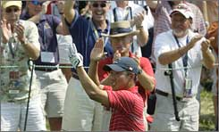 Anthony Kim applauds with the gallery early in his match Sunday against Sergio Garcia.