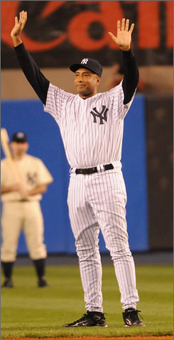 Bernie Williams acknowledges the Yankee Stadium crowd when he was introduced during the pregame ceremonies before New York hosted Baltimore in the venue's final game.