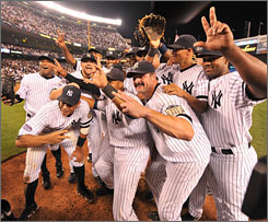 The Yankees pose after winning the final game at Yankee Stadium over the Orioles 7-3.