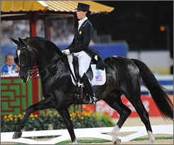 American equestrian Courtney King rides Mythilus during the individual dressage competition at the Beijing Olympics in August. Team USA's fourth-place finish has been nullified after the horse was found to have tested positive for high levels of an anti-inflammatory drug.