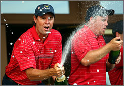Paul Azinger, left, and J.B. Holmes celebrate the United States' Ryder Cup victory Sunday at Valhalla Golf Club.