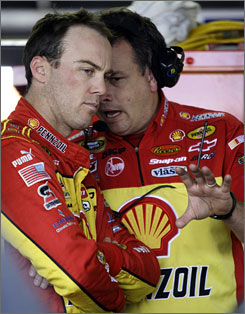 Kevin Harvick, left, who sits fifth in the Chase for the Sprint Cup standings, believes he and his team, including crew chief Todd Berrier, still have the momentum to win the title.