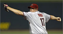 Arizona's Brandon Webb allowed two runs in seven innings and earned his 22nd win as the Diamondbacks beat the St. Cardinals 4-2 in St. Louis.