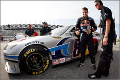 Former Champ Car star A.J. Allmendinger, left, hasn't enjoyed much success in his first Sprint Cup season and it's not yet known if he'll continue to drive the No. 84 Toyota in the last eight races.