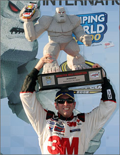 It wasn't easy, but Greg Biffle managed to pull of this balancing act with an unwieldy Dover trophy in victory lane.