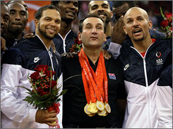 Coach Mike Krzyzewski celebrates with the U.S. basketball team after they won the gold medal over Spain at the Olympic Games in Beijing.