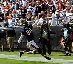 "Brandon Lloyd celebrates after scoring a touchdown when the Bears blocked a punt by the Panthers in Week 2. ""Special teams is underrated a little bit,"" Bears special-teamer Israel Idonije says. ""Football is a game of field position. Field position gives you more chances to score."