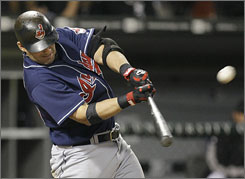 Cleveland's        Ryan Garko launches a grand slam in the fifth inning against the Chicago White Sox to lead the Indians to an 11-8 win in Chicago. Garko also hit a solo home run in the fourth inning.