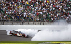 Denny Hamlin does a burn out to celebrate winning the Kansas Lottery 300 at Kansas Speedway, in Kansas City, Kan. Hamlin held off Nationwide Series points leader Clint Bowyer for the win.