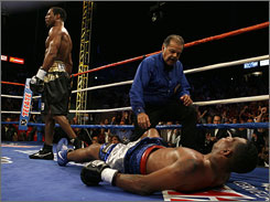 Shane Mosley walks away after knocking out Ricardo Mayorga in the 12th round of their junior middleweight bout.