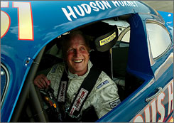 Paul Newman took a few laps around the Lowe's Motor Speedway near Charlotte in 2006 at the wheel of a classic 1951 Hudson Hornet. The actor, who died Friday at 83, was active in auto racing at the same time his performing career began to take off.