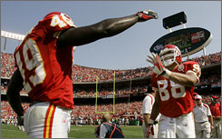 Kansas City's Bernard Pollard, left, congratulates Tony Gonzalez after the TE's touchdown catch on Sunday.