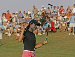 Lorena Ochoa celebrates after her win in the Navistar LPGA Classic in Prattville, Ala. Ochoa defeated Candie Kung and Cristie Kerr in a playoff and finished 15-under par.