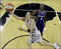 San Antonio Silver Stars guard Becky Hammon scores in front of the Los Angeles Sparks' DeLisha Milton-Jones during Game 3 of the Western Conference finals in San Antonio. Hammon scored a game-high 35 points to lead the Silver Stars to a 76-72 win and their first trip to the WNBA Finals.