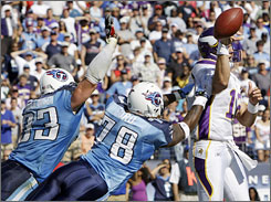 Titans defender Jacob Ford blocks a pass by Vikings QB Gus Frerotte during the fourth quarter on Sunday.