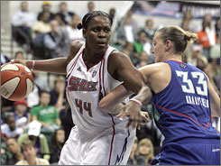 The Shock's Taj McWilliams-Franklin, left, fends off the Liberty's Cathrine Kraayeveld during the first half of Detroit's Game 3 victory in the Eastern Conference Finals.