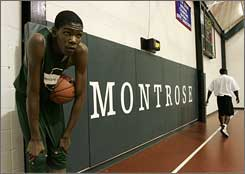 Montrose Christian, seen here a couple of years ago with Kevin Durant at practice, would be one of the teams in a proposed postseason tournament.