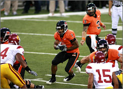 Despite his small size, Jacquizz Rodgers, center, is averaging 112.2 yards-per-game rushing for the Oregon State Beavers. Rogers stands just 5-7.