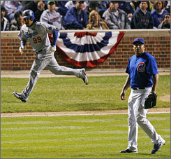 Los Angeles Dodgers left fielder Manny Ramirez rounds the bases after hitting a home run off Chicago Cubs starting pitcher Carlos Zambrano during the fifth inning of Game 2 of the National League Division Series at Wrigley Field in Chicago. Ramirez, who went 2-for-4 with two RBI has two home runs in the 2008 postseason.