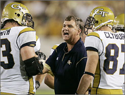 """Paul Johnson talks with his team during a time out in their win over Jacksonville State on Aug. 28. """"The biggest part is getting them (players) to buy in"""" to his new option offense, Johson says."""