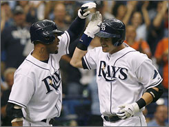 Rays hitter Evan Longoria, right, is congratulated by teammate Carl Crawford after his second home run in Game 1.