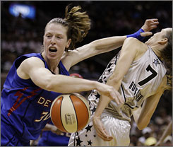 Detroit Shock guard Katie Smith, left, is fouled by San Antonio Silver Stars forward Erin Buescher during second-quarter action in Game 1 of the WNBA Finals in San Antonio. Smith, with 25 points, helped put the visiting Shock up 1-0 in the series.