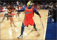 Warriors mascot Thunder warms up the crowd before a 2005 game against the Rockets.