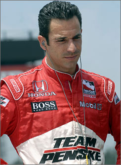 Helio Castroneves  shown at the Honda Indy 200 in Lexington, Ohio, last summer  is free on bail after pleading innocent to federal tax evasion charges.