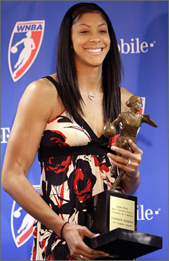 The Sparks' Candace Parker poses with her trophy after being named the WNBA's MVP in San Antonio. Parker, who averaged 18.5 points and 9.5 rebounds this past season, also won rookie of the year honors.