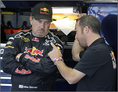 Mike Skinner, left, talks with Jimmy Elledge during a testing session at Lowe's Motor Speedway in Concord, N.C., on Sept. 23. Skinner has replaced A.J. Allmendinger in the Red Bull Racing Team's No. 84 Camry.