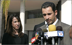 "Helio Castroneves, the two-time Indianapolis 500 winner and TV ""Dancing With The Stars"" champion pauses while talking to reporters on Friday outside of federal court after posting a $10 million dollar bond on charges of conspiracy and tax evasion. Katiucia Castroneves, left, the driver's sister and business manager, is also facing charges."