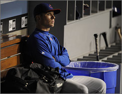 Chicago starting pitcher Rich Harden watches as the Los Angeles Dodgers celebrate after sweeping the Cubs following Game 3 of the National League Division Series in Los Angeles. The Dodgers won the game 3-1 and advanced to the National League Championship Series for the first time since 1988.