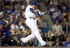 Los Angeles first baseman James Loney doubles and drives in two runs in the first inning to get the Dodgers off to a hot start against the Chicago Cubs during Game 3 of their National League Division Series in Los Angeles. The Dodgers won the game 3-1 to eliminate the Cubs from the playoffs.