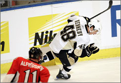 Tyler Kennedy celebrates his second goal of the game, in the last minute of overtime, which gave the Penguins a 4-3 win over Ottawa in the NHL's opener in Stockholm.