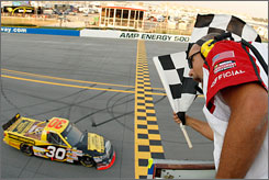 Todd Bodine, driver of the No. 30 Lumber Liquidators Toyota, crosses the finishline to win the NASCAR Craftsman Truck Series Mountain Dew 250 at Talladega Superspeedway. Bodine took the lead on the final turn of the last lap and held of Ron Hornaday Jr. and Kyle Busch.