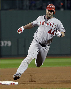 Los Angeles Angels catcher Mike Napoli, who homered twice earlier in the game, rounds third base en route to scoring the winning run on an      Erick Aybar single in the 12th inning of Game 3 of the American League Division Series in Boston. The Angels beat the Red Sox 5-4 to force a Game 4.