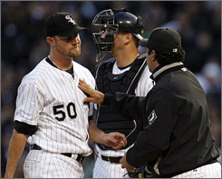 With the White Sox's season riding on him for a second consecutive start, John Danks, left, gave manager Ozzie Guillen and Co. exactly what they needed.