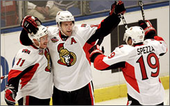 Ottawa's Dany Heatley, center, celebrates with teammates after scoring his second goal of the game in the third period of the Senators' 3-1 win over Pittsburgh in Stockholm on Sunday.