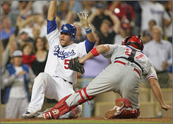 Russell Martin roars home with the winning run in the last of the ninth of the Dodgers' 4-3 victory over the Phillies on Aug. 12. Los Angeles and Philadelphia play for the National League pennant starting Thursday at Citizens Bank Park.