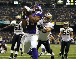Minnesota Vikings tight end Visanthe Shiancoe catches a touchdown pass from running back Chester Taylor during the second quarter against the New Orleans Saints. The Vikings beat the Saints 30-27 on a field goal with 13 seconds remaining in the game.