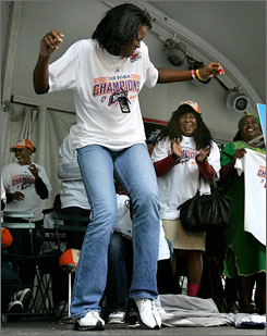 Shock forward Taj McWilliams-Franklin dances in front of city councilwoman Martha Reeves as she is introduced at a victory rally in downtown Detroit.