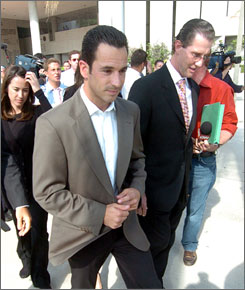 The alleged crimes of IndyCar driver Helio Castroneves, center, didn't draw the same outcry as those of football player Michael Vick.
