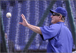 Dodgers' third-base coach Larry Bowa, above, and Phillies' first-base coach Davey Lopes were on opposite ends of a controversial play in the 1977 NLCS.