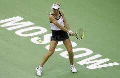 Russia's Elena Dementieva prepares to smack a return in her victory Wednesday against Slovenia's Katarina Srebotnik in the Kremlin Cup in Moscow.