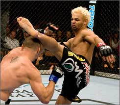Josh Koscheck kicks Chris Lytle in their July bout.