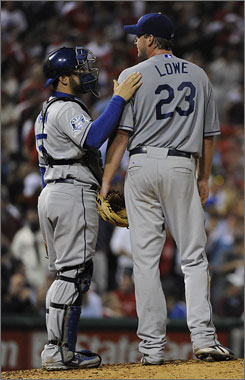 Dodgers catcher Russell Martin tries to settle pitcher Derek Lowe in the sixth inning after Shane Victorino advanced to second on an error.