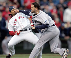 Rays pitcher James Shields takes a swing at Coco Crisp after Crisp was hit by a pitch and charged the mound during a game June 5 in Boston.