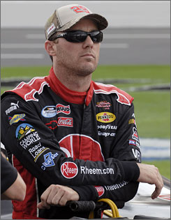 Kevin Harvick watches from pit road before his qualifying run for the NASCAR Nationwide Series Dollar General 300 at Lowe's Motor Speedway in Concord, N.C. Harvick and Carl Edwards have been sniping at each other all week after Edwards triggered a 12-car crash during the race at Talladega Superspeedway last weekend.