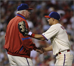 Philadelphia center fielder Shane Victorino, right, shakes hands with his manager, Charlie Manuel, after the Phillies beat the Dodgers 8-5 to take a 2-0 lead in the NLCS. It was a bittersweet win for Manuel, whose 87 year-old mother, June Manuel, passed away earlier in the day.