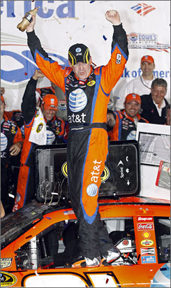 Jeff Burton celebrates after winning the Bank of America 500 at Lowe's Motor Speedway in Concord, N.C.